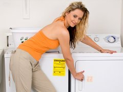 Slender housewife masturbates in the laundry room