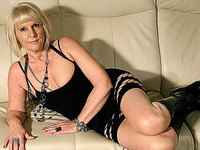 Nasty blonde old bitch in leather boots is licking a sex device