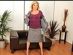 Tan blond cougar masturbates with a glass toy after work